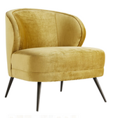 "Occasional chairs are known for their sense of casual luxury. The Kitts Chair is no exception, built plush and sturdy for whatever your lifestyle brings. The curved back gives you ample support, while the sloping arms keep you curled up inside. Upholstered in a plush, marigold velvet with welting details to accentuate the curves. The base rests on tapered, light bronze finished metal legs that have a hint of glisten. Also available in Flax Linen (8119) and Muslin (8120). H33"" W29"" D33"""
