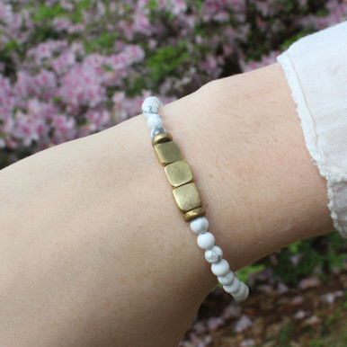 Skinny Howlite (calming) Stone Bracelet. Hand-molded Brass Accent Bead for natural good. Stretch Bracelet. 7 inches.