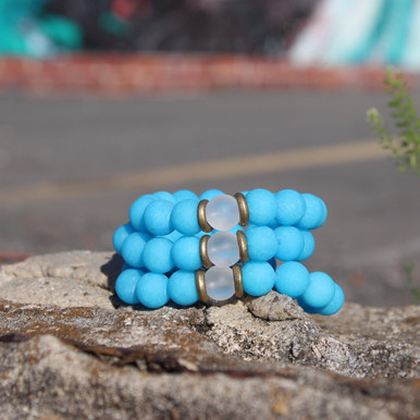 It is all about the STATEMENT this season bigger and bold bracelets with simple chain, enjoy this three pack of bracelets go minimal or max out your wristwear. Jade and Clear Quartz Stone. Brass. Stretch Bracelet. 7inches.
