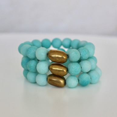 It is all about the STATEMENT, go BOLD with BRYN+MCKENNA's personal growth bracelets in Jade. Jade Stone=Harmony. Brass=Natural Good. Brass Bead Shape=Personal Growth. Stretch Bracelet. 7inches.