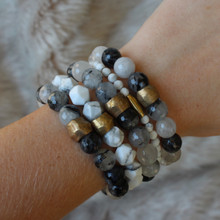 It is all about the STATEMENT, go BOLD with this black/white mix bracelet stack filled with good intentions black tourmaline quartz (combination harmony and tranquility) and howlite (calming). Brass Accents=Natural Good. Stretch Bracelet. 7inches.