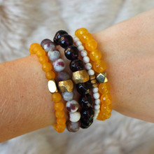 GAME ON with this spirit pack. Stones: Jade/Howlite. Brass Accents. Stretch Bracelet. 7inches.