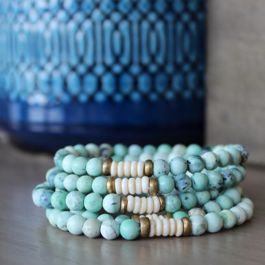 It is all about the STATEMENT, this simple boho soft mix bracelet stack keeps the free spirit in it's flow. Brass Accents=Natural Good. Stretch Bracelet. 7inches.