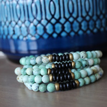 It is all about the STATEMENT, this simple boho mix bracelet stack keeps the free spirit in it's flow. Brass Accents=Natural Good. Stretch Bracelet. 7inches.