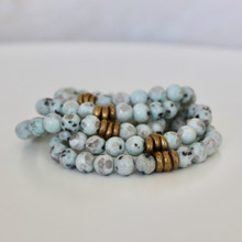 It is all about the STATEMENT, this bracelet stack gives the right pop to any outfit. Kiwi Jasper=Tranquility  Brass Accents=Natural Good. Stretch Bracelet. 7inches.