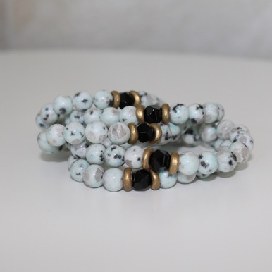 It is all about the STATEMENT, this bracelet stack gives the right pop to any outfit. Kiwi Jasper=Tranquility  Onyx=Strength Brass Accents=Natural Good. Stretch Bracelet. 7inches.
