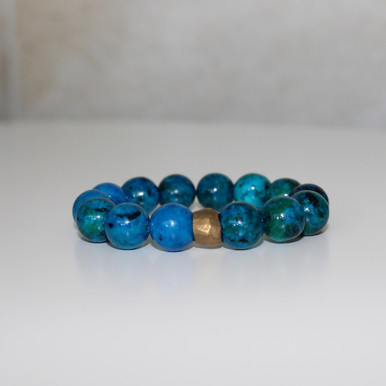 Beaded Bracelet . Handmolded Brass Accent for natural good. Stretch Bracelet. 7 inches.