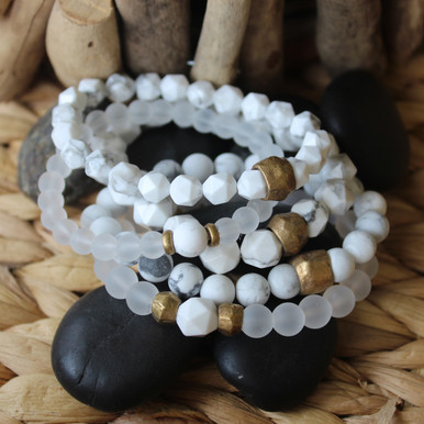 It is all about the STATEMENT, this bracelet stack gives the right pop to any outfit. Clear Quartz=clarity, Howlite=calming, Brass Accents=Natural Good. Stretch Bracelet. 7inches.