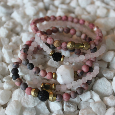 It is all about the STATEMENT, this bracelet stack gives the right pop to any outfit. , Rhodonite - love/clear communication Lava Rock=healing courage, Rose Quartz=Peace/Forgiveness, Rhodochrosite=compassion, Brass Accents=Natural Good. Stretch Bracelet. 7inches.
