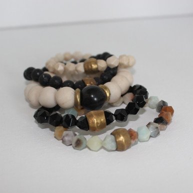 It is all about the STATEMENT, this bracelet stack gives good vibes to any girl boss. Fossil Coral=hospitality, Onyx=strength, Amazonite=soothing/creativity, Lava Rock=healing courage, Brass Accents=Natural Good. Stretch Bracelet. 7inches.