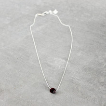 The Garnet (Energizing) Necklace inspired design promotes true expression through love and kindness. It can be worn as a choker or as a necklace up to 18 inches. Garnet = Love | Chain = Sterling Silver