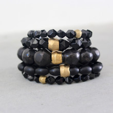 It is all about the STATEMENT, go BOLD with BRYN+MCKENNA's bracelets in onyx, agate, and horn. Onyx Stone=Positivity, Strength, Confidence. Agate=harmony body/mind/soul. Brass=Natural Good. Stretch Bracelet fit small to mid-sized wrist. 7inches. Larger size bracelets available upon request/special order contact customerservice@brynmckenna.com subject line: Special Order Size 8.
