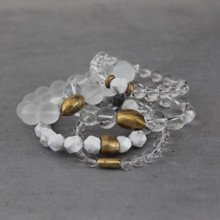 It is all about the STATEMENT, go BOLD with BRYN+MCKENNA's bracelets in clear quartz and howlite. Clear Quartz Stone=Clarity|Renewed Energy. Howlite=Calying. Brass=Natural Good. Stretch Bracelet fit small to mid-sized wrist. 7inches. Larger size bracelets available upon request/special order contact customerservice@brynmckenna.com subject line: Special Order Size 8.