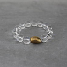Clear Crystal Quartz Bracelet (clarity/purity/patience). Handmolded Brass Accent for natural good. Brass Bean=Personal Growth. Stretch Bracelet. 7 inches.