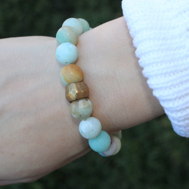 Amazonite soothing, encourages balance and creativity. Handmolded Brass Accent for natural good. Stretch Bracelet. 7 inches. Limited Quantities.