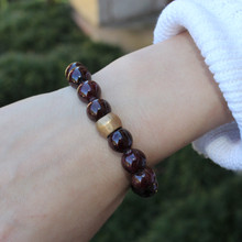 Garnet|Gratitude, prosperity, and abundance.  Hand-molded Brass Accent for natural good. Stretch Bracelet. 7 inches. Limited Quantities.