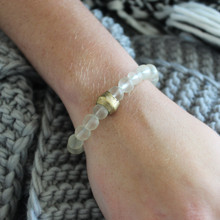 Glass Bracelet. Hand-molded brass accent for natural good. Stretch Bracelet. 7 inches. Limited quantities.
