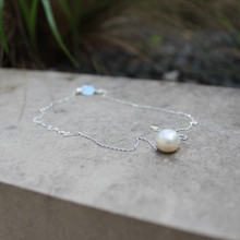 The Pearl (peacefulness) Necklace it can be worn as a choker or as a necklace up to 18 inches. Chain = Sterling Silver