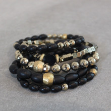 The art of the mix! Pile on the shine with this pyrite and onyx blend.  Brass=Natural Good. Stretch Bracelet fit small to mid-sized wrist. 7inches. Larger size bracelets available upon request/special order contact customerservice@brynmckenna.com subject line: Special Order Size 8.