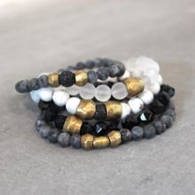 The art of the mix embrace this Wonder Woman blend of larvikite (cleanse)| lava rock (courage) | howlite (calming) | clear quartz (clarity) | agate (harmony). Brass=Natural Good. Stretch Bracelet fit small to mid-sized wrist. 7inches. Larger size bracelets available upon request/special order contact customerservice@brynmckenna.com subject line: Special Order Size 8.