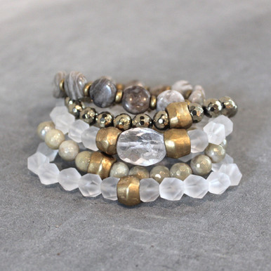 The art of the mix!  Pile on the luster set of silver leaf jasper (will power)| pyrite (strength) | clear quartz (clarity) | titanium glaze amazonite (soothing). Brass=Natural Good. Stretch Bracelet fit small to mid-sized wrist. 7inches. Larger size bracelets available upon request/special order contact customerservice@brynmckenna.com subject line: Special Order Size 8.