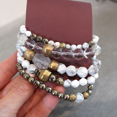 The art of the mix!  Stack on the easy street set of pyrite (strength) | clear quartz (clarity) | howlite (calming). Brass=Natural Good. Stretch Bracelet fit small to mid-sized wrist. 7inches. Larger size bracelets available upon request/special order contact customerservice@brynmckenna.com subject line: Special Order Size 8.