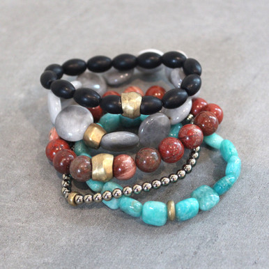 The art of the mix!  Pile on the positivity with onyx (strength) | eagle eye  jasper (independence)| red jasper (empowerment) | pyrite (strength) | amazonite (soothing). Brass=Natural Good. Stretch Bracelet fit small to mid-sized wrist. 7inches. Larger size bracelets available upon request/special order contact customerservice@brynmckenna.com subject line: Special Order Size 8.