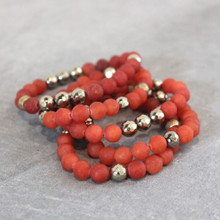 The art of the mix!  Just groove on with this fun orange set that combines jade (harmony) and  a sparkle of pyrite (strength). Brass=Natural Good Stretch Bracelet fit small to mid-sized wrist. 7inches. Larger size bracelets available upon request/special order contact customerservice@brynmckenna.com subject line: Special Order Size 8.