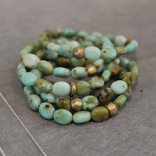 The art of the mix!  Glow everyday with this stone mutation of aventurine (optimism and self confidence) blended with turquoise (leadership). Brass=Natural Good Stretch Bracelet fit small to mid-sized wrist. 7inches. Larger size bracelets available upon request/special order contact customerservice@brynmckenna.com subject line: Special Order Size 8.