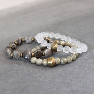 The art of the mix!  Pile on the luster set of silver leaf jasper (will power) | clear quartz (clarity) | titanium glaze amazonite (soothing). Brass=Natural Good. Stretch Bracelet fit small to mid-sized wrist. 7inches. Larger size bracelets available upon request/special order contact customerservice@brynmckenna.com subject line: Special Order Size 8.