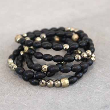 The art of the mix! A Total Eclipse with this pyrite and onyx blend.  Brass=Natural Good. Stretch Bracelet fit small to mid-sized wrist. 7inches. Larger size bracelets available upon request/special order contact customerservice@brynmckenna.com subject line: Special Order Size 8.