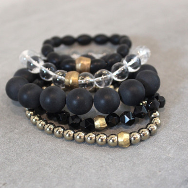 The art of the mix! Clear vision ahead with this onyx (positivity)|clear quartz (clarity)|pyrite (strength) blend.  Brass=Natural Good. Stretch Bracelet fit small to mid-sized wrist. 7inches. Larger size bracelets available upon request/special order contact customerservice@brynmckenna.com subject line: Special Order Size 8.