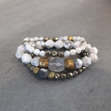 The art of the mix!  Stack on the easy street trio set of pyrite (strength) | clear quartz (clarity) | howlite (calming). Brass=Natural Good. Stretch Bracelet fit small to mid-sized wrist. 7inches. Larger size bracelets available upon request/special order contact customerservice@brynmckenna.com subject line: Special Order Size 8.