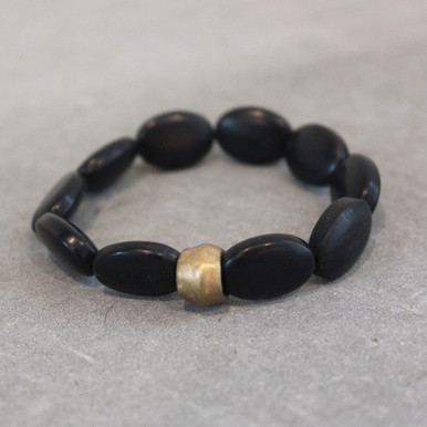 Breathe out the negativity and soothe the soul with onyx. Brass=Natural Good. Stretch Bracelet fit small to mid-sized wrist. 7inches. Larger size bracelets available upon request/special order contact customerservice@brynmckenna.com subject line: Special Order Size 8.