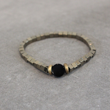 Breathe IN positivity, strength and courage with pyrite and onyx. Brass=Natural Good. Stretch Bracelet fit small to mid-sized wrist. 7inches. Larger size bracelets available upon request/special order contact customerservice@brynmckenna.com subject line: Special Order Size 8.