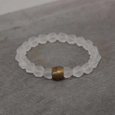 Vividly clear with matte clear quartz. Brass=Natural Good. Stretch Bracelet fit small to mid-sized wrist. 7inches. Larger size bracelets available upon request/special order contact customerservice@brynmckenna.com subject line: Special Order Size 8.