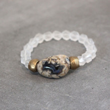 Clearly serene with matte clear quartz and dreamy chalcedony. Brass=Natural Good. Stretch Bracelet fit small to mid-sized wrist. 7inches. Larger size bracelets available upon request/special order contact customerservice@brynmckenna.com subject line: Special Order Size 8.