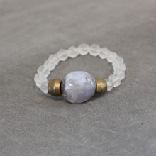 Clearly serene with matte clear quartz and dreamy blue chalcedony. Brass=Natural Good. Stretch Bracelet fit small to mid-sized wrist. 7inches. Larger size bracelets available upon request/special order contact customerservice@brynmckenna.com subject line: Special Order Size 8.
