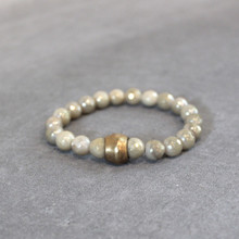 L-O-V-E the soothing luster of titanium glazed amazonite. Brass=Natural Good. Stretch Bracelet fit small to mid-sized wrist. 7inches. Larger size bracelets available upon request/special order contact customerservice@brynmckenna.com subject line: Special Order Size 8.
