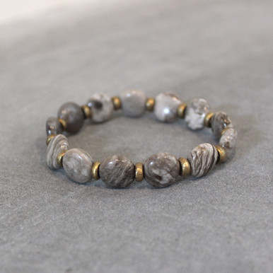 Now that's the spirit,  just float on with clarity and vision of silver leaf jasper. Brass=Natural Good. Stretch Bracelet fit small to mid-sized wrist. 7inches. Larger size bracelets available upon request/special order contact customerservice@brynmckenna.com subject line: Special Order Size 8.