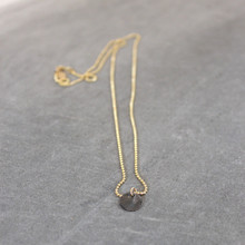 Nothing but endless space and limitless possibilities with this feel good steele and gold-filled necklace. Chain 24 inches. Chain = gold filled.