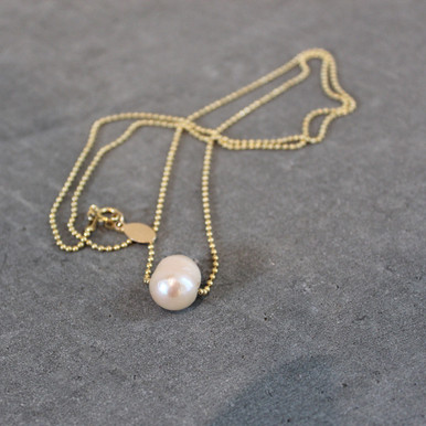 Let there be peace and tranquility with this freshwater pearl necklace. Chain 24 inches. Chain = gold filled.