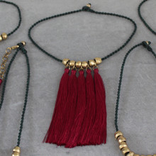 The Bohemian Stand Out Necklace bold red color tassels with flattering lines. It's a STATEment on it's own or layered. Surfer Cord; Length 18 inches.