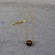 Let there be peace and tranquility with this freshwater pearl necklace. Chain 22 inches adjustable. Chain = gold filled.