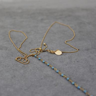 Accented with small soft blue stones to remind us to always have strength and the confidence in our abilities