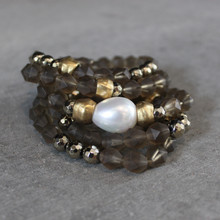 The art of the mix! ONLY Warm Wishes -  with this jade, pyrite and mother-of-pearl focal bead blend.  Brass=Natural Good. Stretch Bracelet fit small to mid-sized wrist. 7inches. Larger size bracelets available upon request/special order contact customerservice@brynmckenna.com subject line: Special Order Size 8.