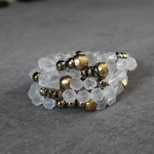 The art of the mix! Glisten with this matte clear quartz and pyrite blend.  Brass=Natural Good. Stretch Bracelet fit small to mid-sized wrist. 7inches. Larger size bracelets available upon request/special order contact customerservice@brynmckenna.com subject line: Special Order Size 8.