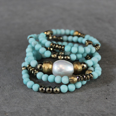 The art of the mix! Happiness Karma with this jade, pyrite and mother-of-pearl focus bead blend.  Brass=Natural Good. Stretch Bracelet fit small to mid-sized wrist. 7inches. Larger size bracelets available upon request/special order contact customerservice@brynmckenna.com subject line: Special Order Size 8.