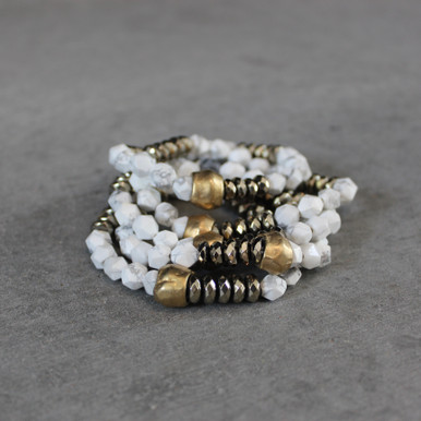 The art of the mix! RESET Happy with this howlite and pyrite blend.  Brass=Natural Good. Stretch Bracelet fit small to mid-sized wrist. 7inches. Larger size bracelets available upon request/special order contact customerservice@brynmckenna.com subject line: Special Order Size 8.