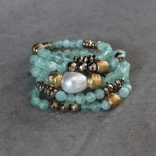 The art of the mix! Cozy up color with this Fluorite and pyrite blend.  Brass=Natural Good. Stretch Bracelet fit small to mid-sized wrist. 7inches. Larger size bracelets available upon request/special order contact customerservice@brynmckenna.com subject line: Special Order Size 8.